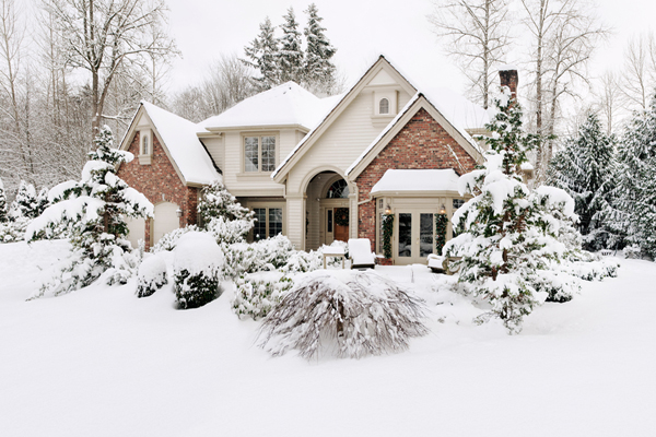 Brick Style Home and Lawn Covered in Snow