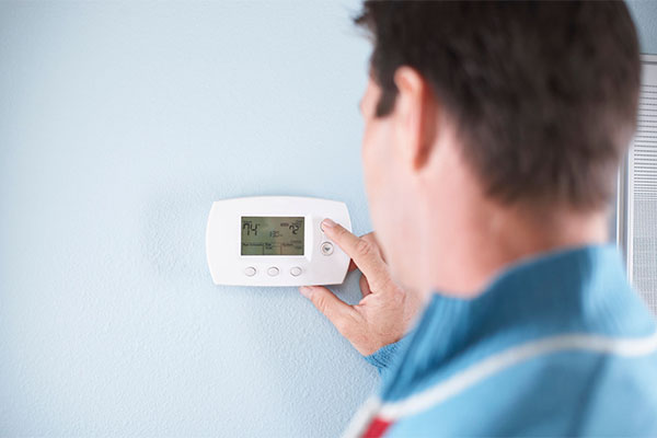 Male Sets The perfect Temperature on His Thermostat