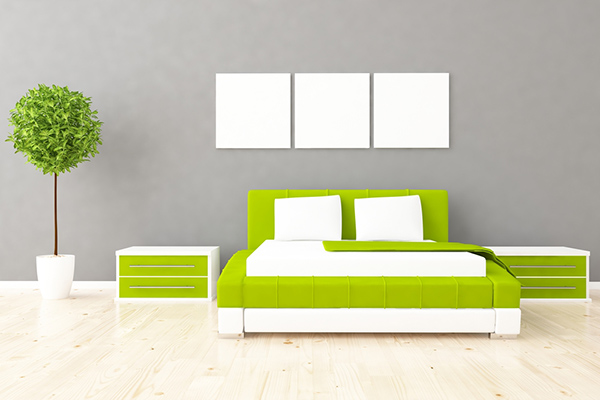 Green Bedroom Furniture in Front of Gray Wall