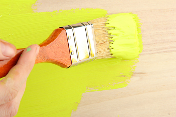 A Wood Finish Being Painted Green