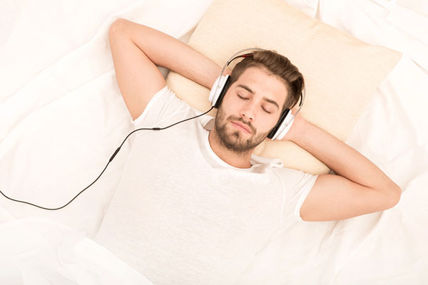 Man listening to music with eyes closes