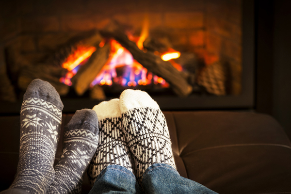 Feet by a ventless fireplace