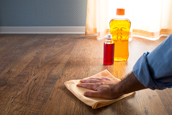 Cleaning Hardwood Floors with cleaner and rag