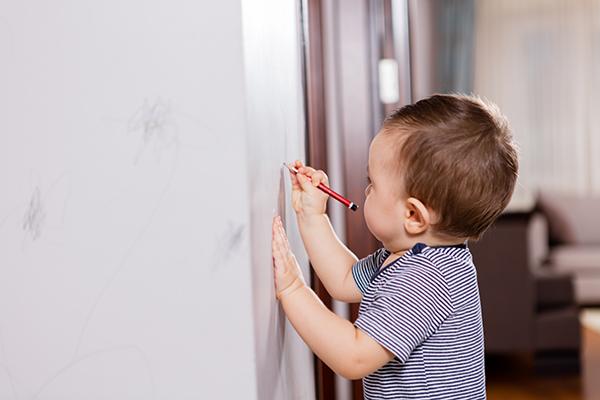 Child writing on wall