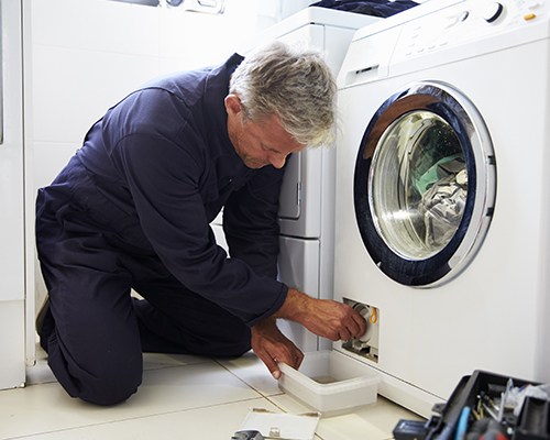 Contractor fixing washing machine